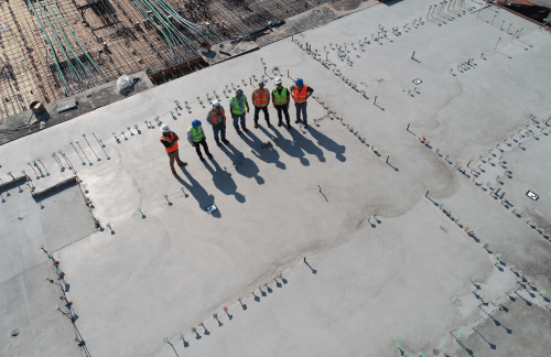 Aerial view of construction executives on a roof